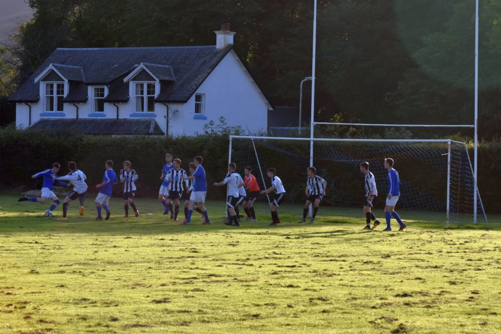 A crowded penalty box as Brodick desperately try to score among a sea of Lamlash players.