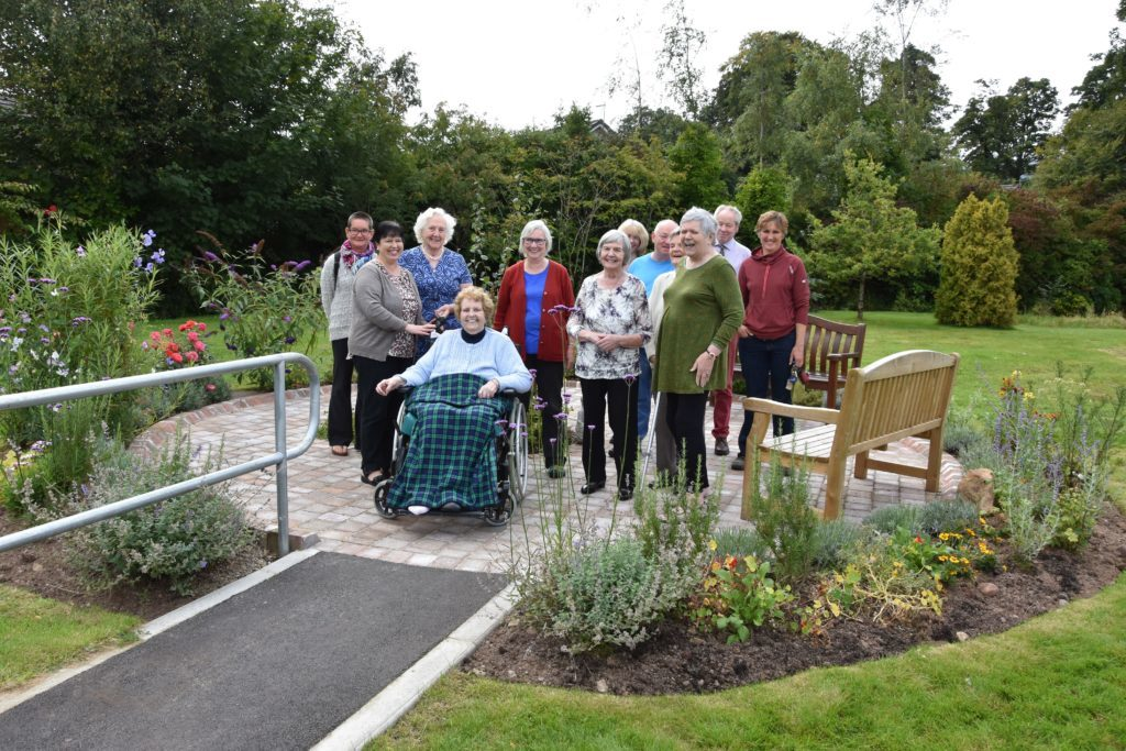 Attending guests, residents and visitors at the official opening of the sensory garden.