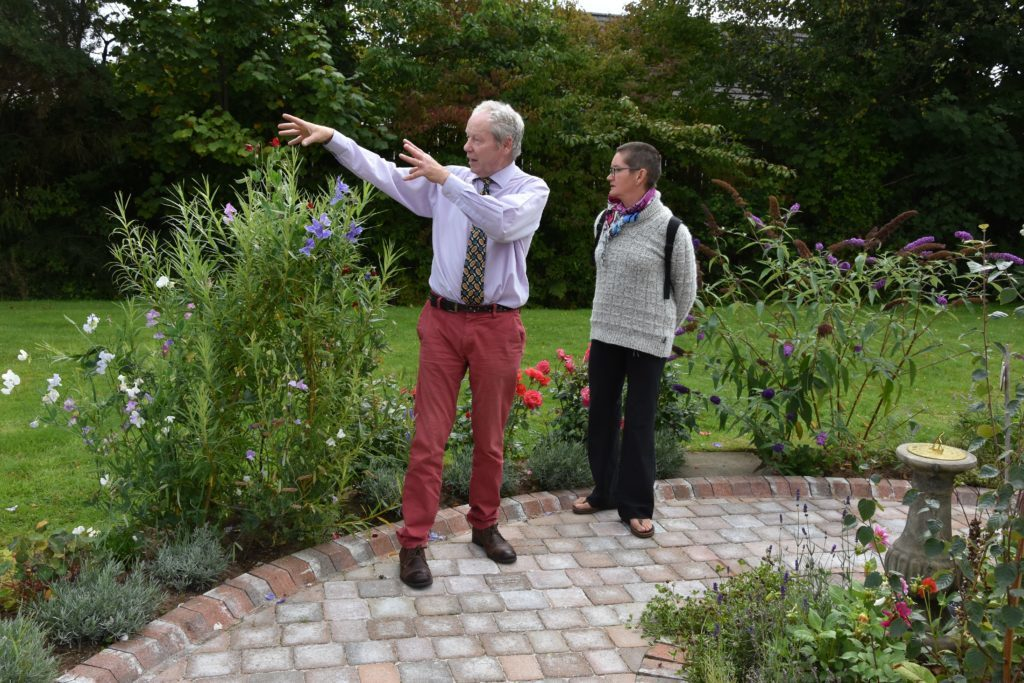 Gardener Colin Totty talks visitors through the choice of plants that were selected for the garden.