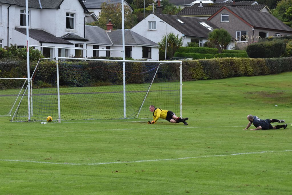 Galston AFC takes the Arran keeper by surprise to score within the first ten minutes.