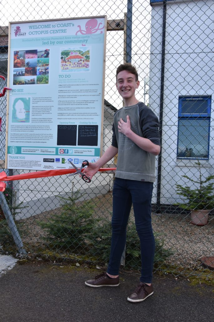 COASTS youngest member Luke Nelson cuts the ribbon, officially opening the Octopus Centre.