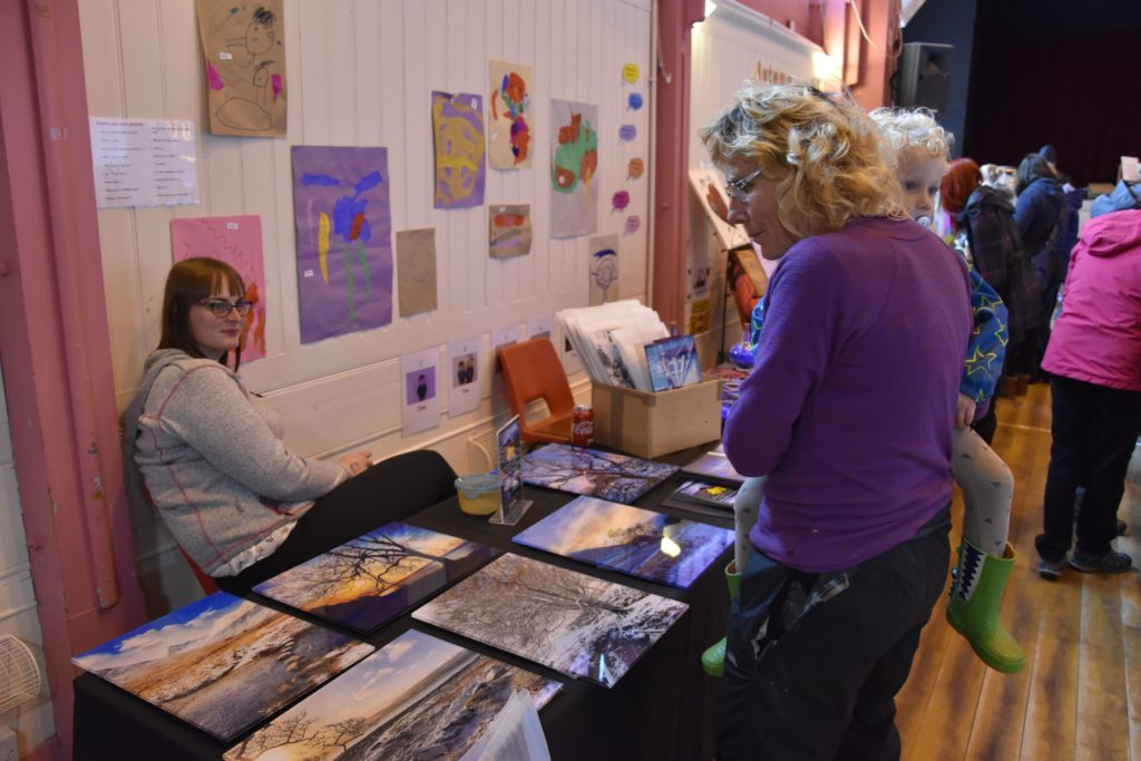 Visitors of all ages browsed the various items on display, including photographs by Natalie Lambie of Unfolding Moments.