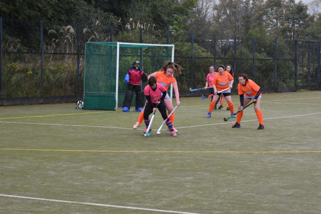 Captain Lorraine Hewie avoids strong resistance to take a trio of shots at goal.