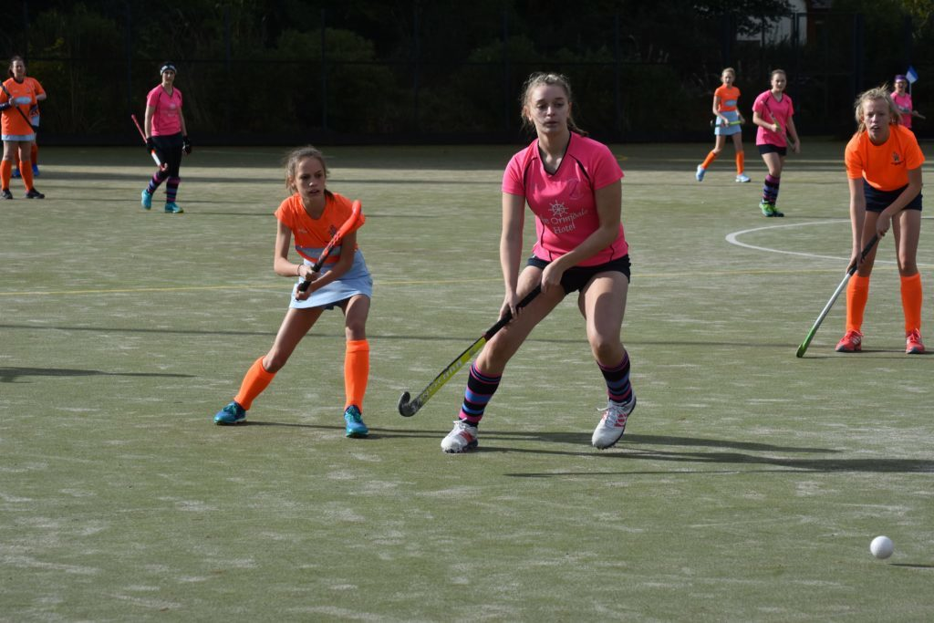 Defender Freya McNicol surges ahead to claim possession of the ball.
