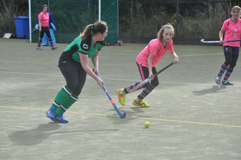 Isla McKevie keeps her eye firmly on the ball as an opponent bears down on her.