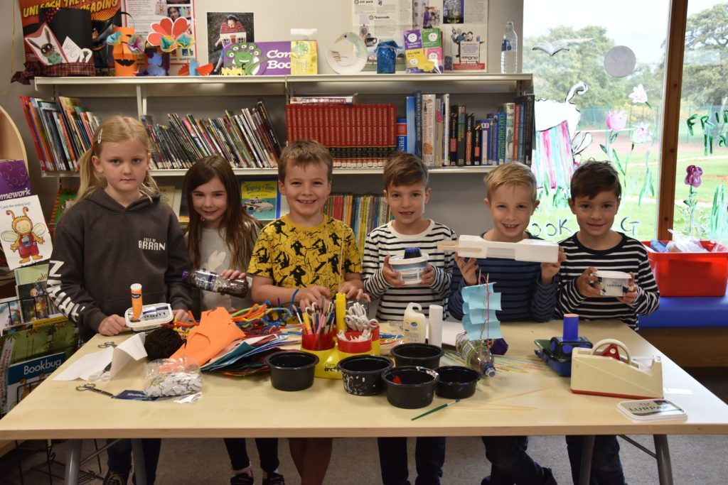 Craft fun. Children at the Arran Library craft morning get to work designing and building boats using recycled materials.
