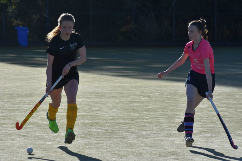 Marking the opposition, an Arran player shadows her Glasgow University opponent to hamper any passing towards the scoring D.