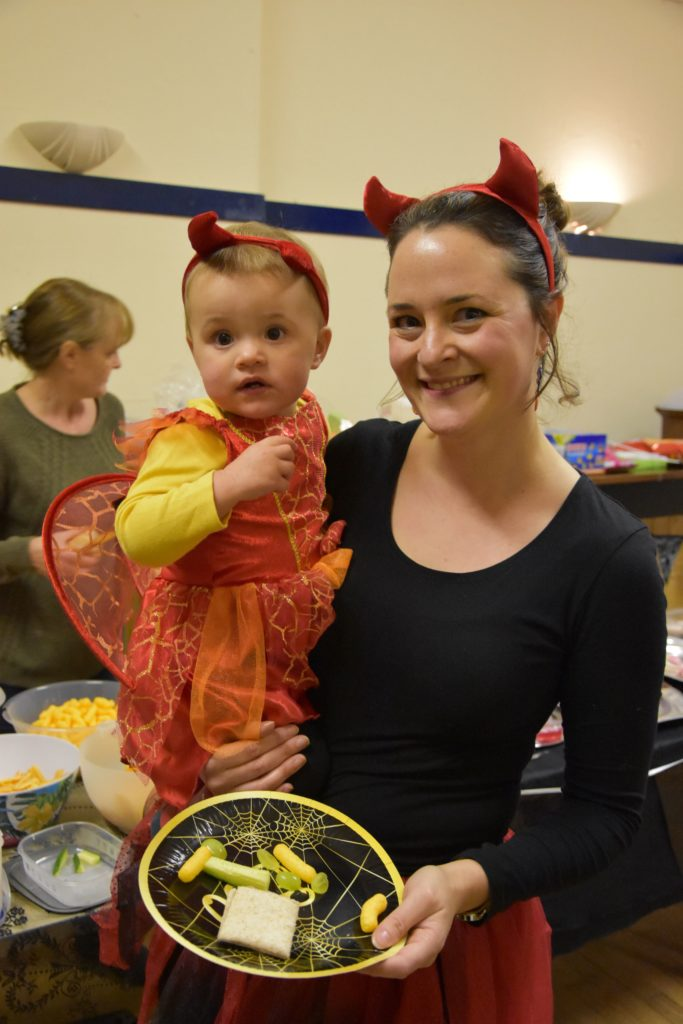 Young Piper enjoys a welcome snack at Whiting Bay's Hallowe'en celebrations with mum Lucy Marriott.