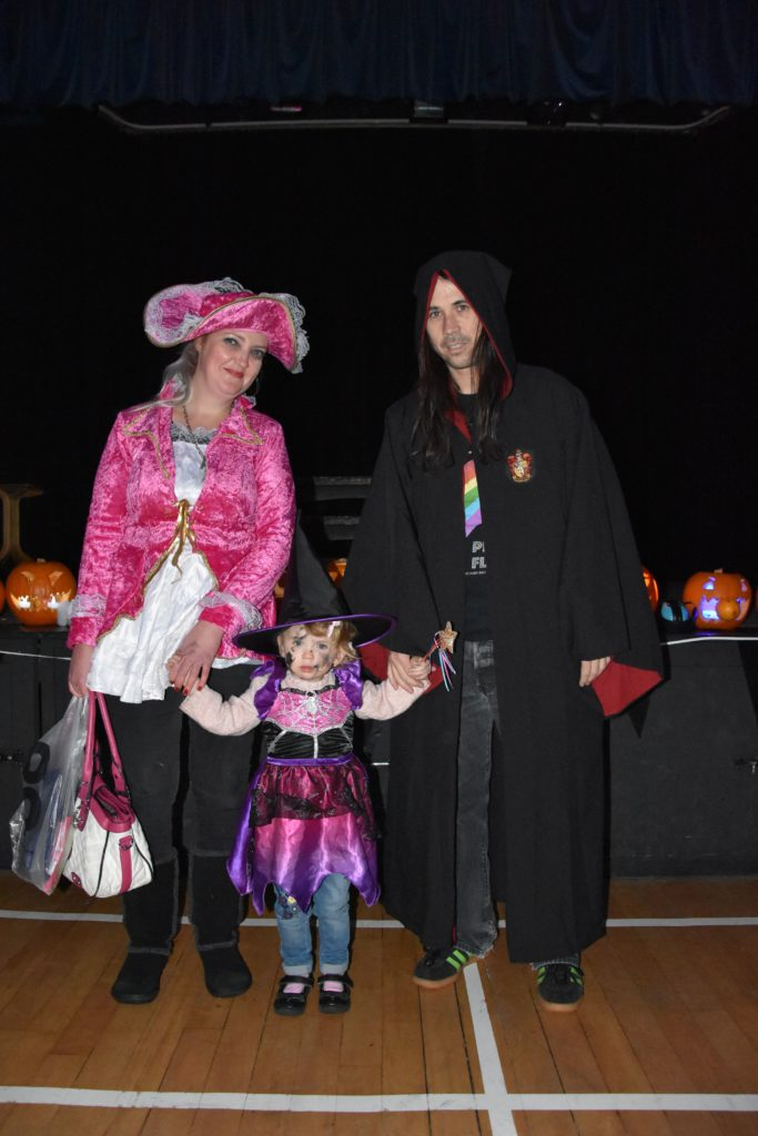 Sweet little witch Arianna joins mum Debbieann and dad Paul McCabe in dressing up for the Whiting Bay Hallowe'en party.