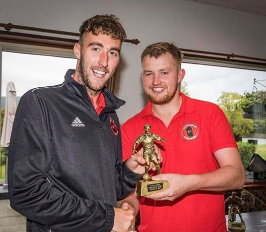 Danny Head presents Ryan Armstrong with the runner up trophy for player of the year. Photograph: David Hogg.