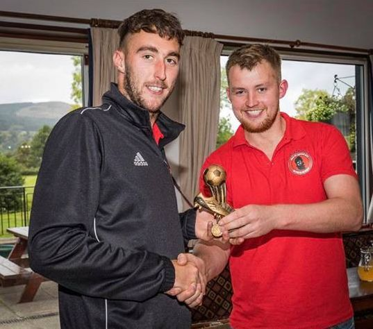 Ryan Armstrong receives the trophy on behalf of Lewis Kennedy and himself who were joint runners-up for golden boot with 21 goals each. Photograph: David Hogg.