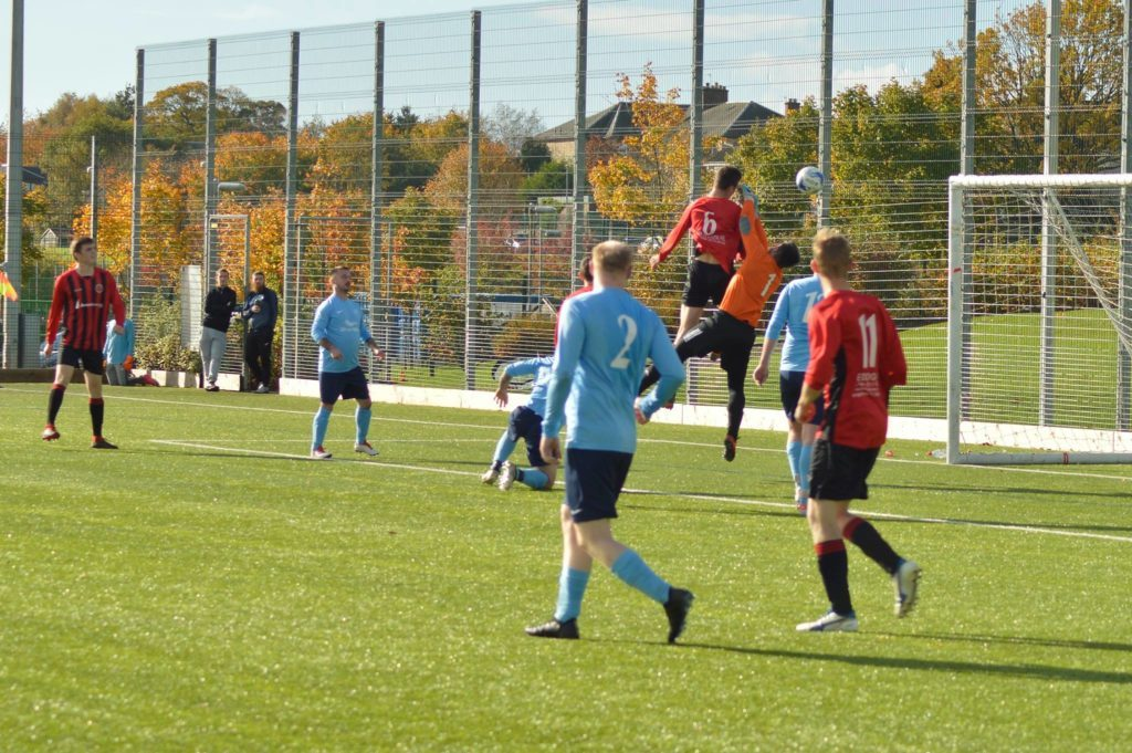 Glencairn keeper attempts to deflect the ball coming from Toby Wingham's header.