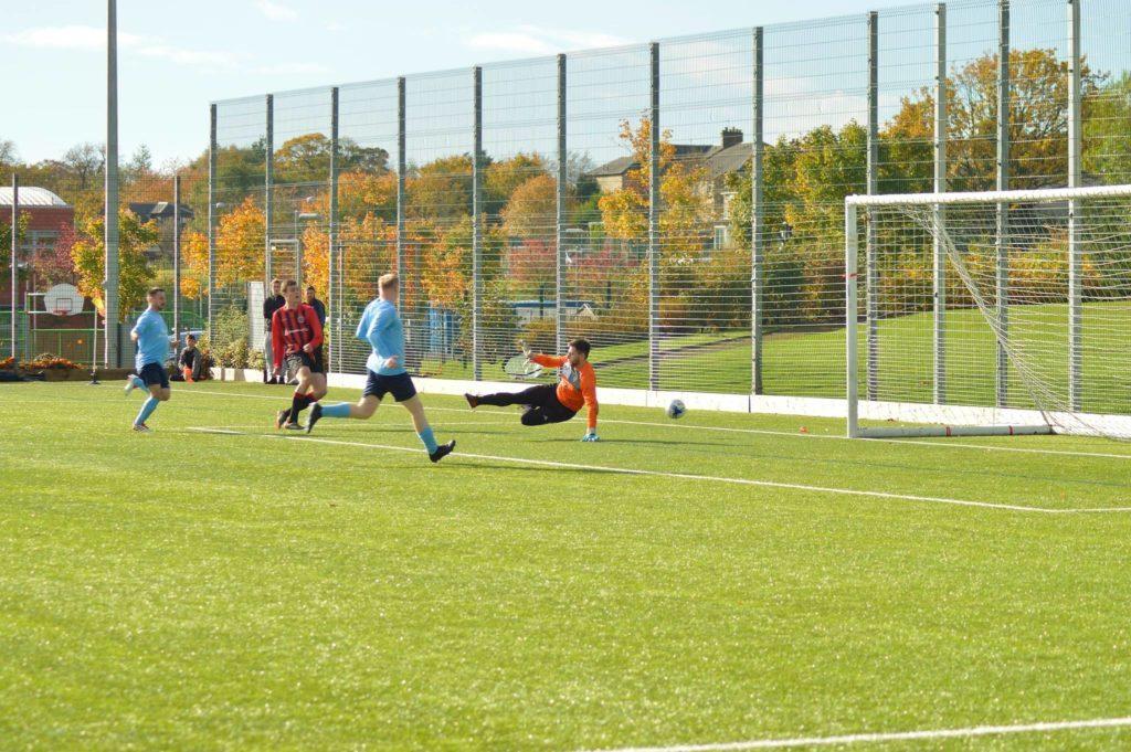 Toby Wingham blasts the ball towards Glencairn's goal.