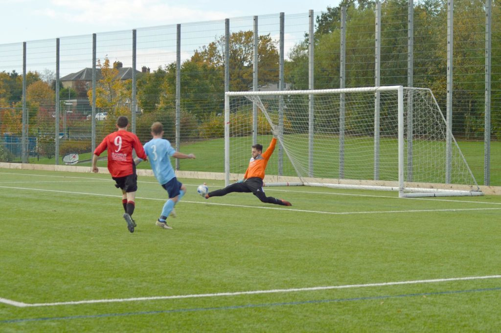 Glencairn keeper throws himself into preventing an Archie McNicol goal.