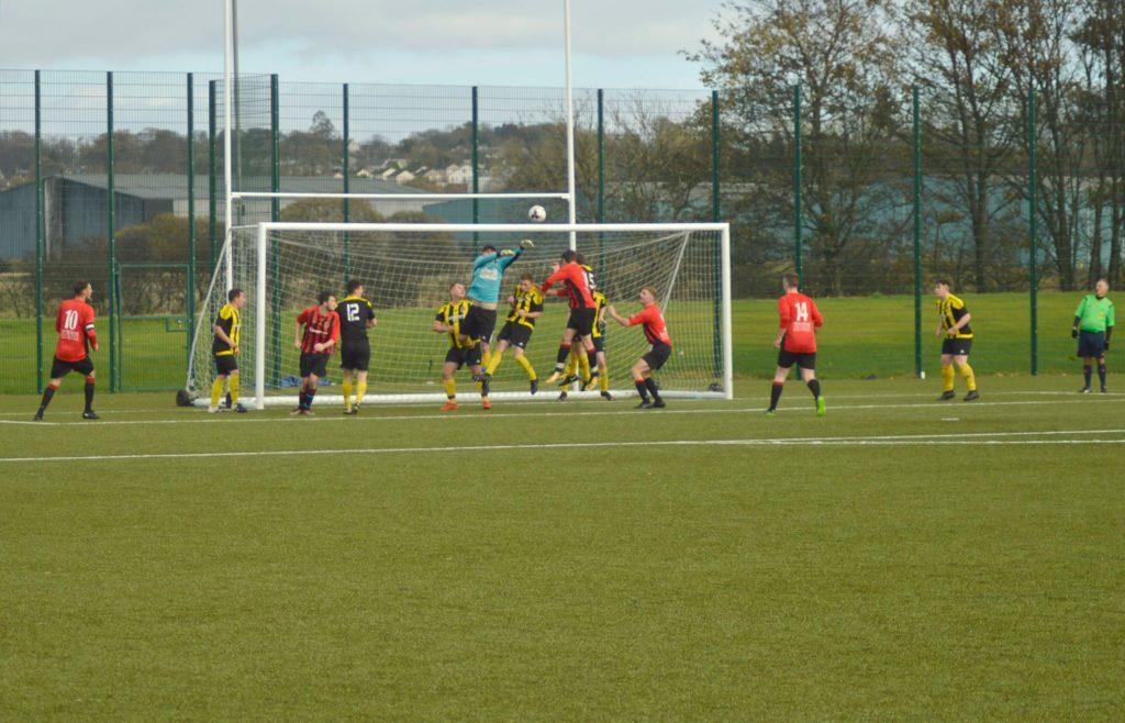 An Arran attempt at goal is denied by the Kilbirnie keeper.