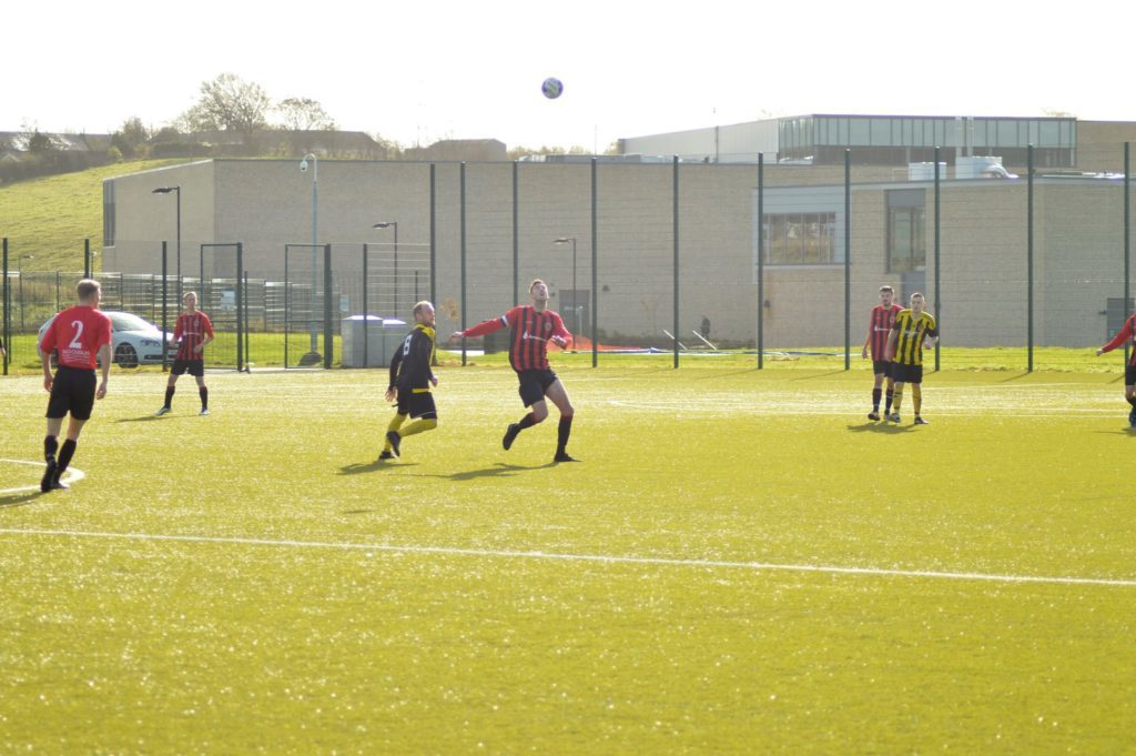 Arran's Ryan Armstrong uses his height advantage to secure an incoming ball.