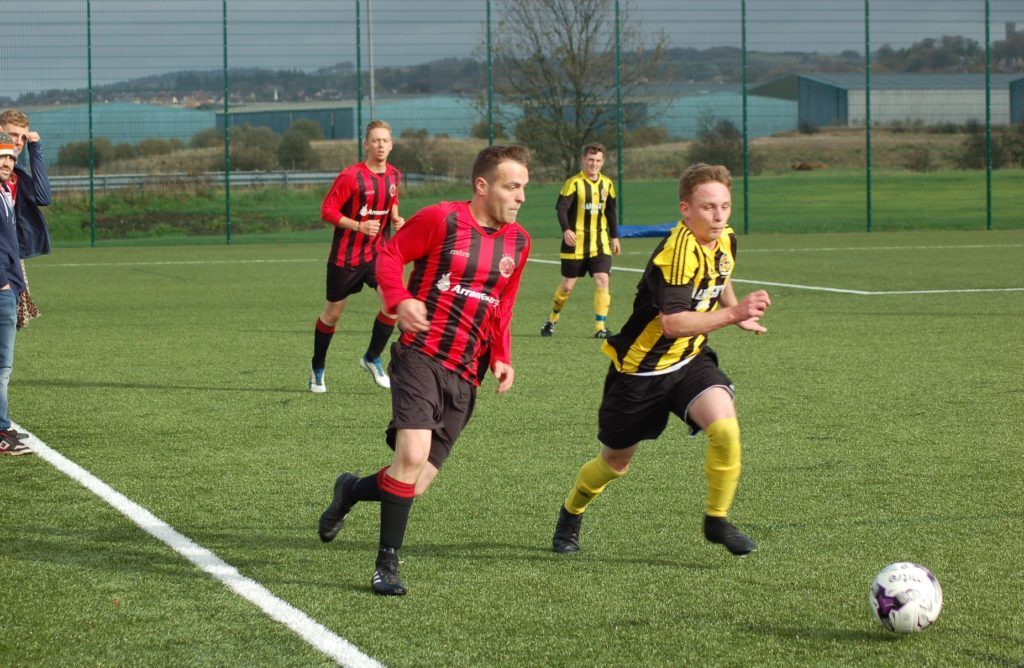 Arran's Chris 'Babbies' MacNeil marks his man in a challenge for possession.