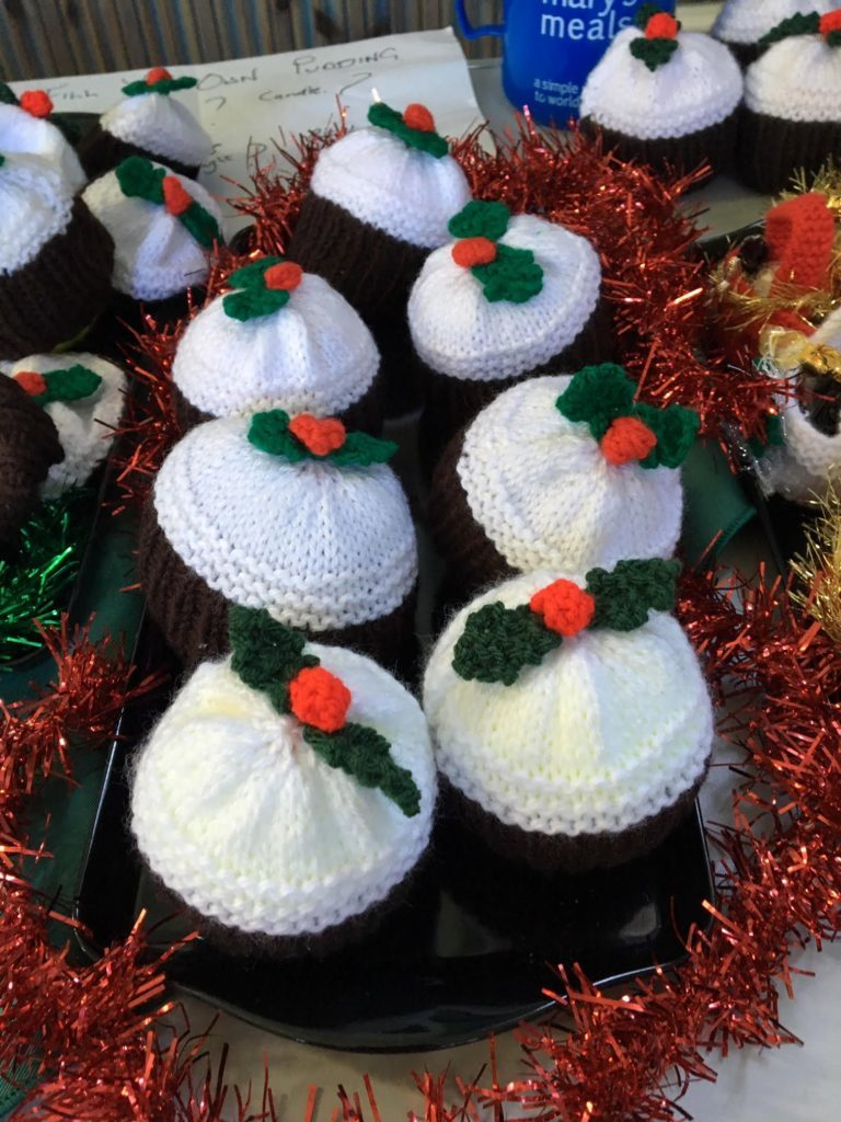 Handmade knitted mindings included these charming Christmas puddings.