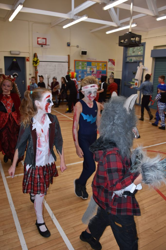 The monsters parade, children walk around the hall during the costume judging.