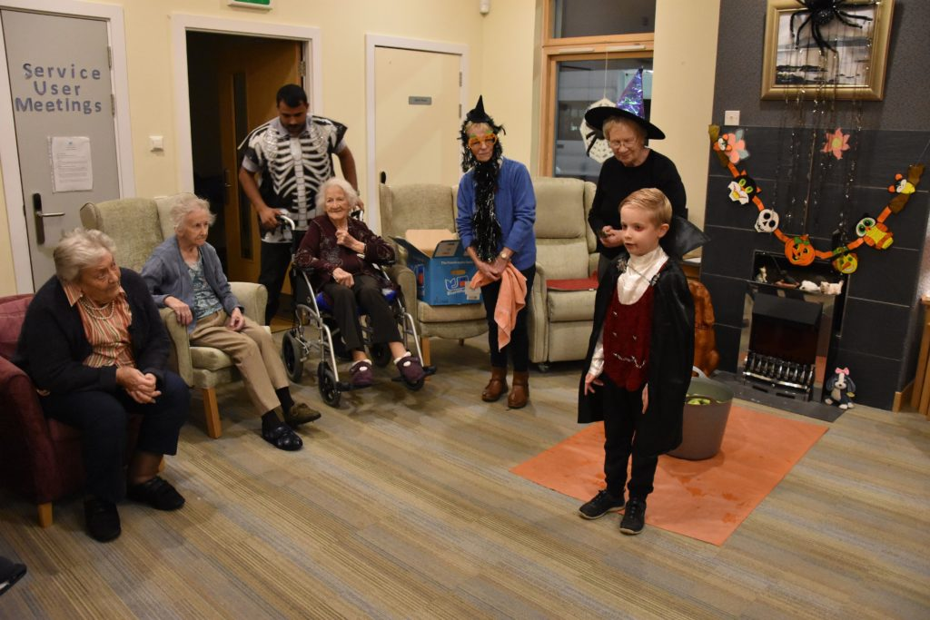 Montrose House residents enjoy one of their young visitors' songs.