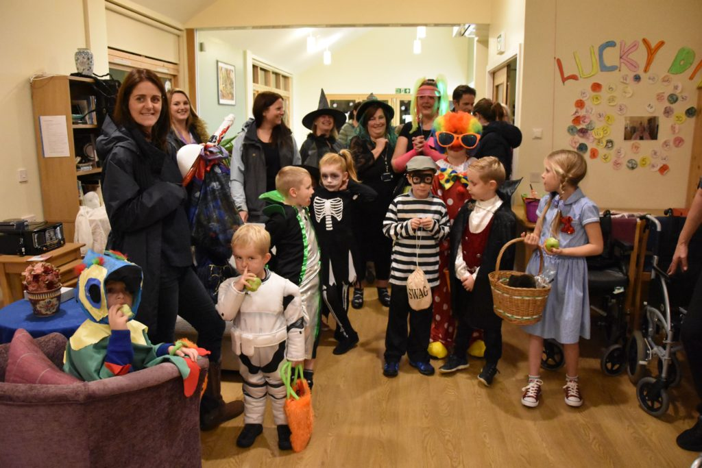 Young guisers at the ready, children arrive in large numbers to visit the residents of Montrose House.