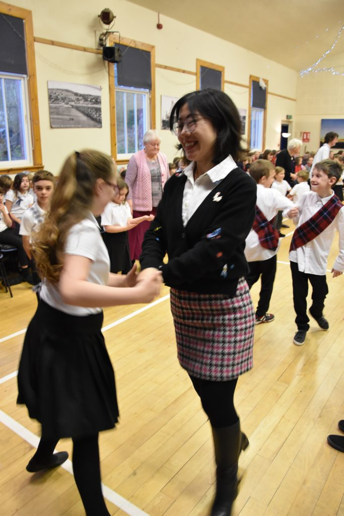 Brodick Primary School's Mandarin teacher enjoys learning the Scottish dances.