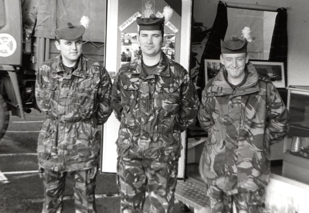 The Royal Highland Fusiliers were recruiting in Arran last week. Photographed on a windswept Brodick front are Fusilier Aaron Sloan, Corporal Harkiss and Fusilier Colin Lewis.