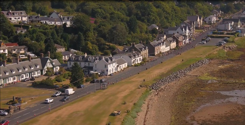 The cyclists sweep through Lamlash in the shot from the show.
