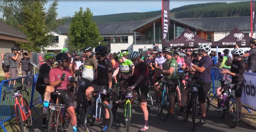 A large group of cyclists at the high school base.