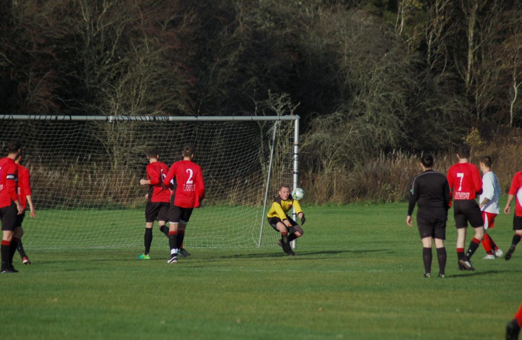 Goalkeeper Stephen Judge intercepts a Valley Thistle attempt at goal.