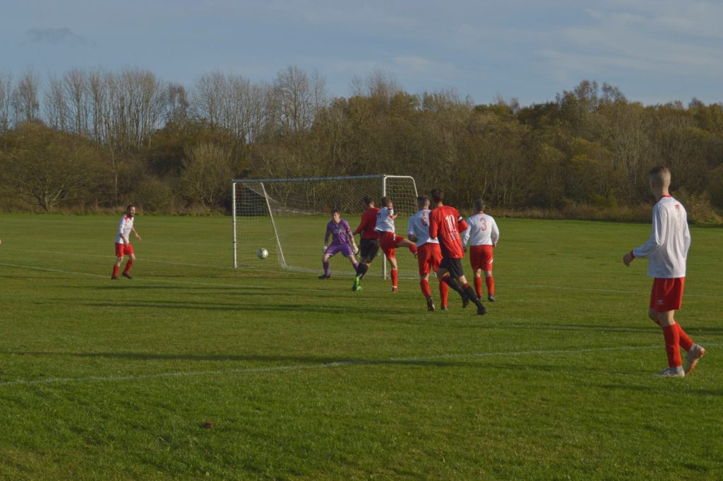 Nick Emsley narrowly misses scoring as the ball goes slightly wide.