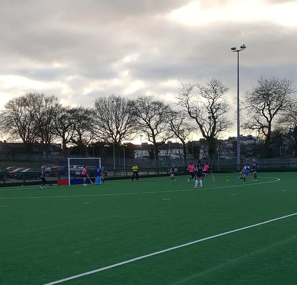 Arran's Jenny Stark rushes out of the D to prevent a GHK attempt at goal.