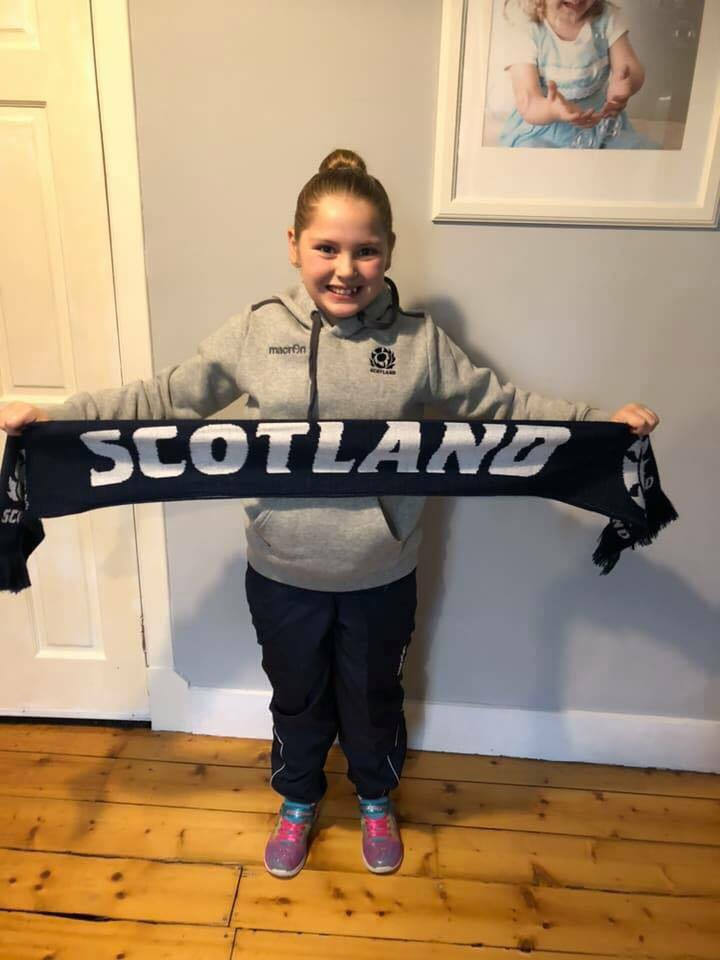 Nine year old Daisy Earle with her Scotland scarf which she received at Murrayfield Stadium.