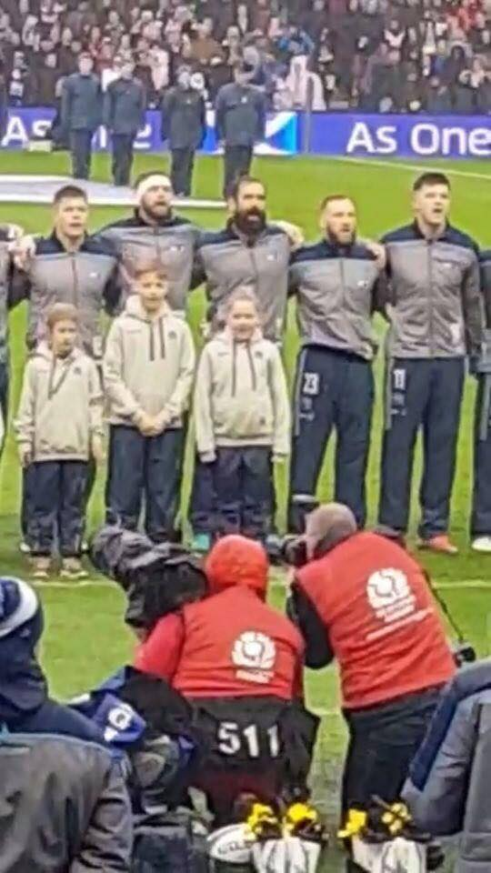 Daisy joins players on the pitch to sing the national anthem.