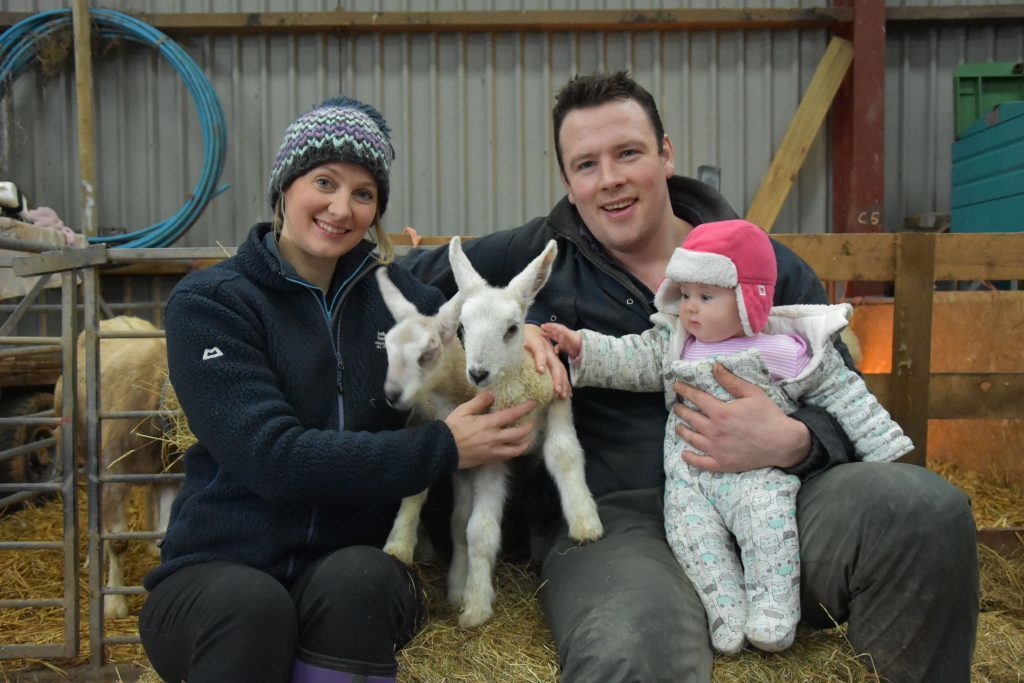 JANUARY - Heralding the start of the new year, Arran's first lambs were born two days after Christmas. Here parents Genevieve and Niall McMaster introduce four-month old Sophie to the new arrivals.