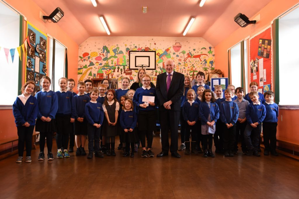 MARCH - The entire Shiskine Primary School show their support for P7 pupil Beth McCarthy who took first place in the annual Burns primary school painting competition.