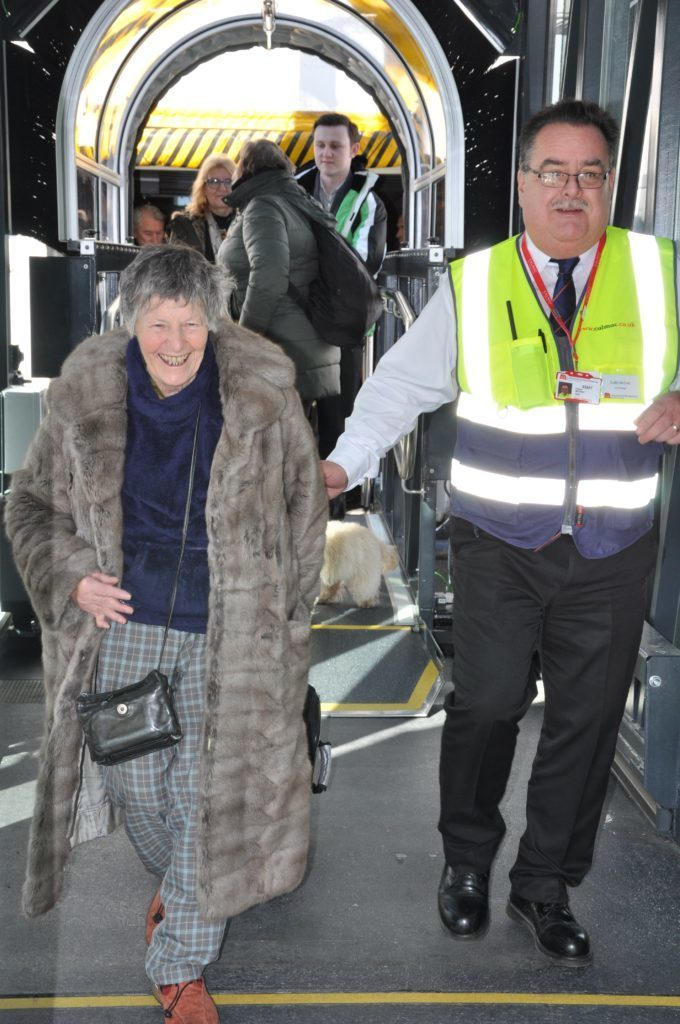 MARCH - Morag Pettigrew is the first passenger to arrive at the new Brodick Ferry Terminal where she is welcomed by port manager Colin McCort.