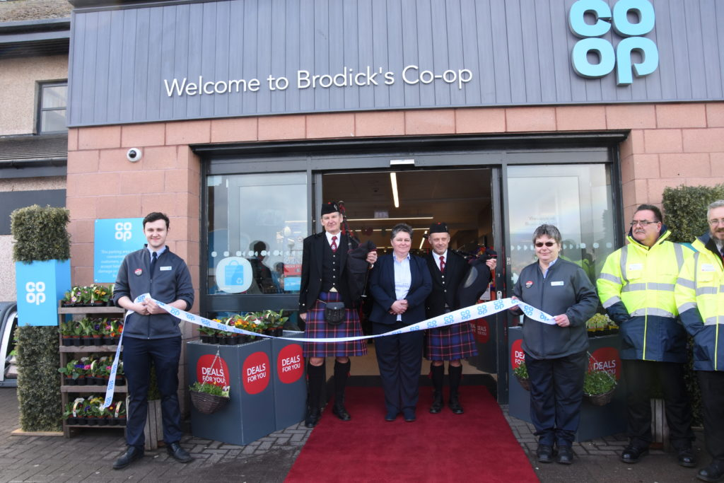 MARCH - Store manager Liz McLean welcomes shoppers to the refurbished Brodick Co-op store at its official opening.