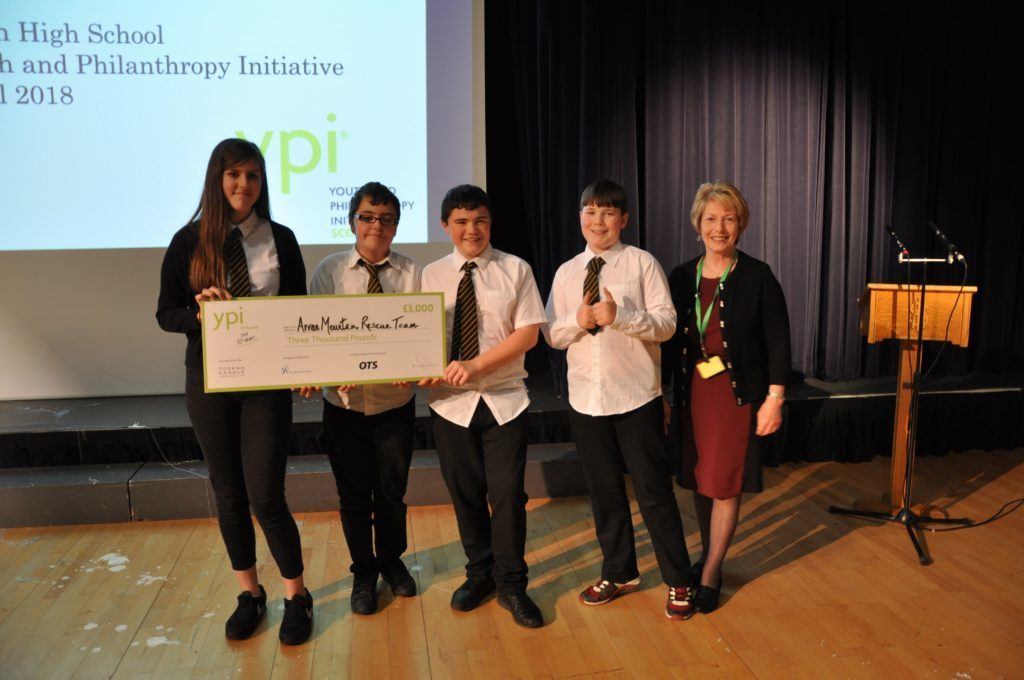 MAY - Arran High School pupils Sam Reid, Gina Boni, James Macis and Euan Kinniburgh earned a bumper £3,000 for the Arran Mountain Rescue Team at the Youth Philanthropy Initiative. Isabel Johnstone, YPI Ayrshire regional facilitator presented the children with the cheque.
