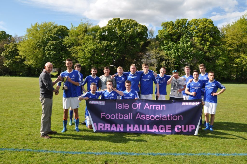 MAY - Willie Anderson of Arran Haulage presents the winning trophy to Brodick captain Matthew Dobson.