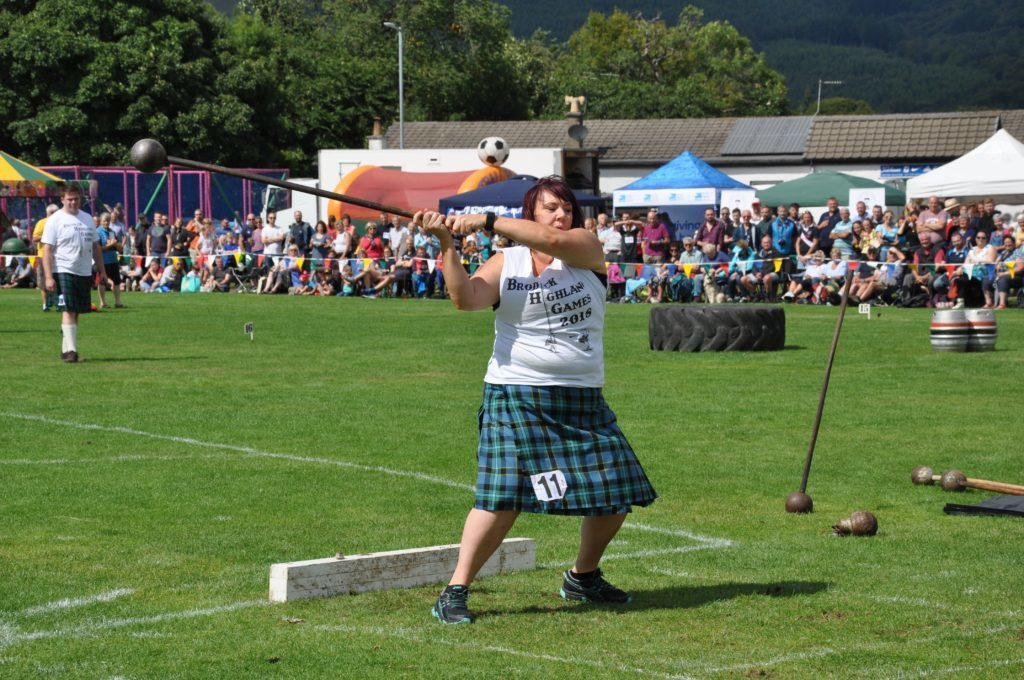 AUGUST - Yvonne Currie makes history as the first female competitor in the heavy events at the Brodick Highland Games.
