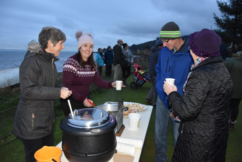 Vivienne Crichton and Kirsty West make sure that visitors are well taken care of with mulled wine and mince pies.