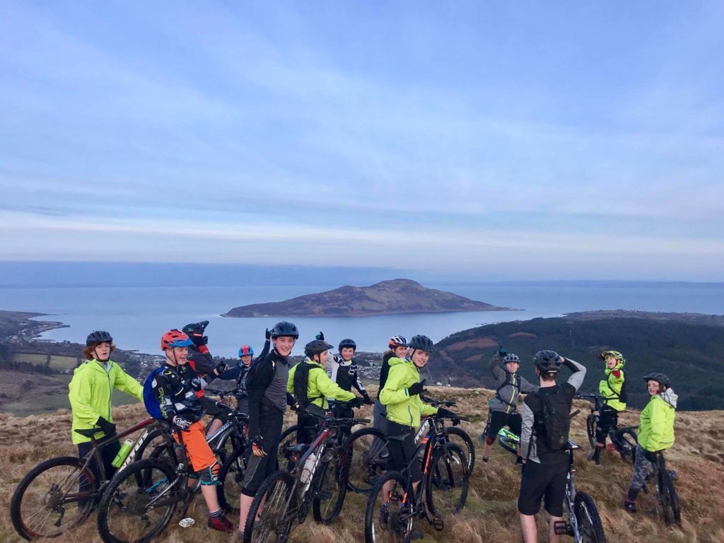 MAY - Members of the Arran High School Mountain Bike Club celebrate a lottery funding boost for purchasing new bicycles which will replace their aging fleet.