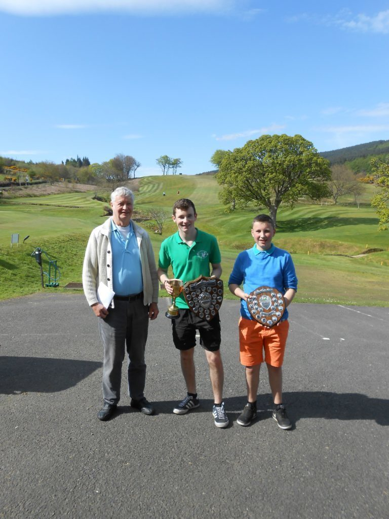MAY - Jim Henderson presents Ross Trail with the Arran Golfers Association Handicap Shield and runner up Rory Currie with the Match Play trophy.