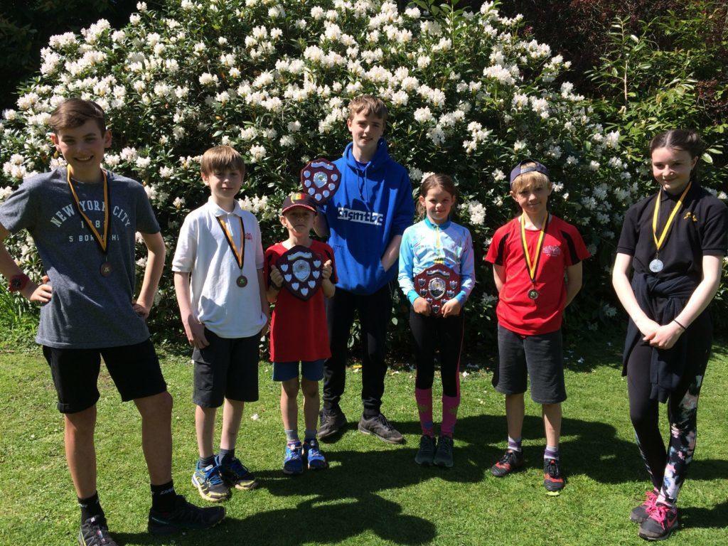 JUNE - Ayrshire Schools Orienteering Championship medal winners, l to r,  Louis Urquart-Dixon, Oscar Inglis, Myles Lindsay-Smith, Charlie Bonner, Rosie McNamara, Ruaridh Lindsay-Smith and Megan McCartney.