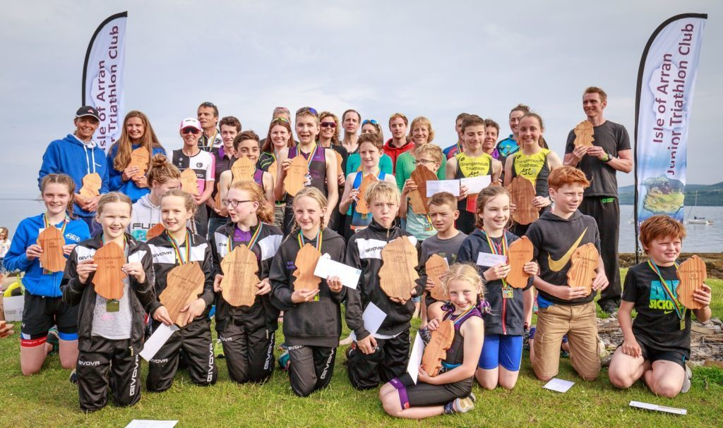 JUNE - The Arran Junior Triathletes pose for a group picture at their home event, the Island-2-Island Triathlon. Photo: Liam Nelson and David Hogg.