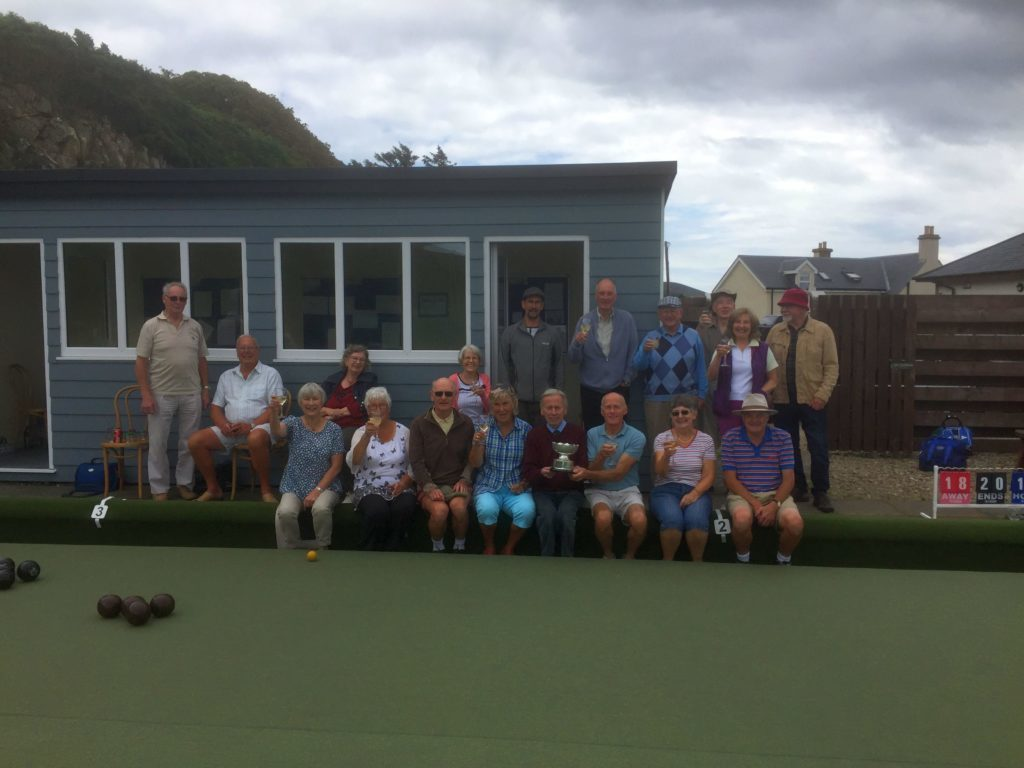 AUGUST - Blackwaterfoot bowlers join the Laidler-Gardner participants in celebrating their win for the first time in 14 years.