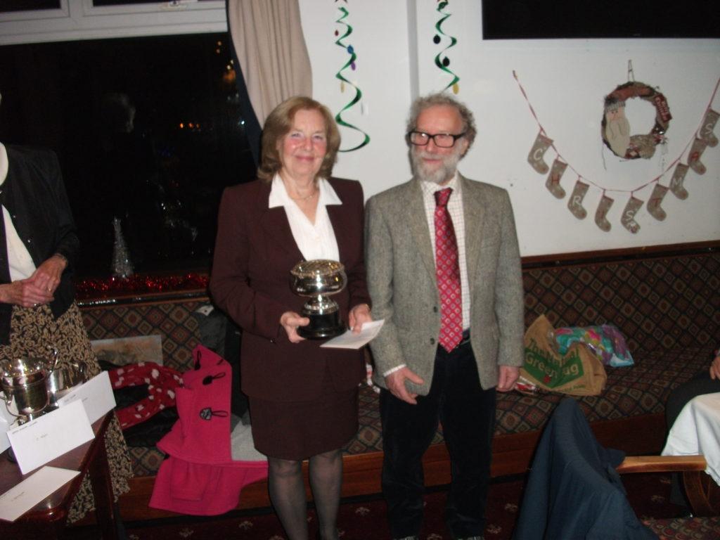 Ladies Singles winner Jenny Douglas receives her trophy from Ian Leader.