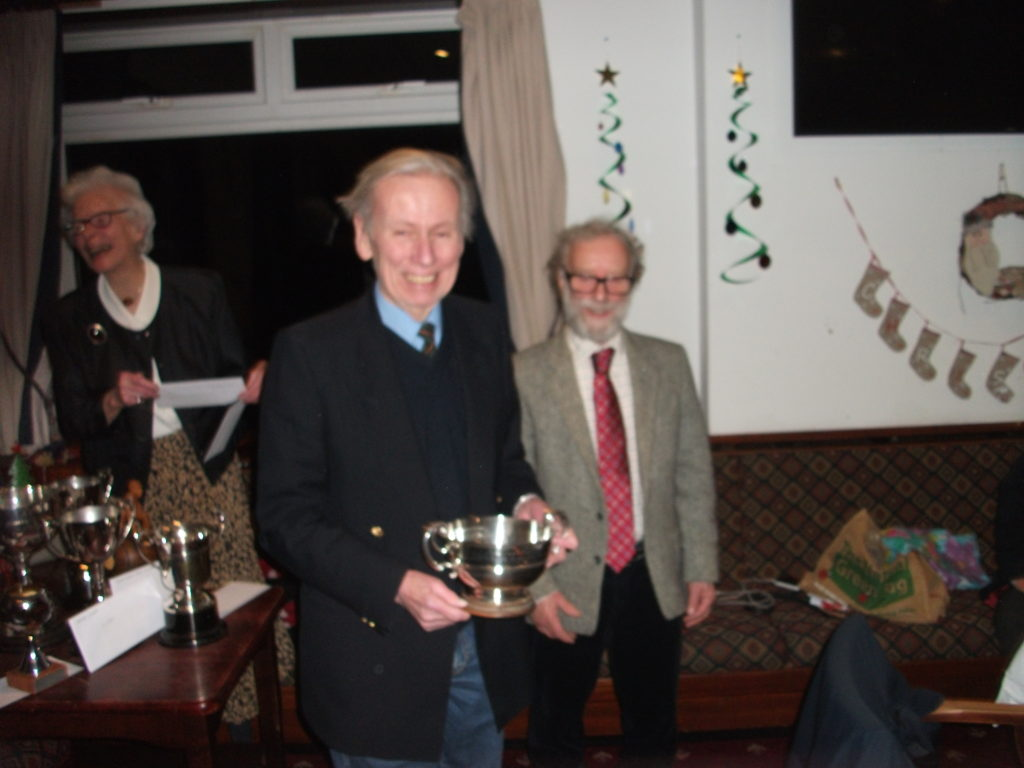 John Robinson receives the Pairs Trophy that he and Charlie Weir won.