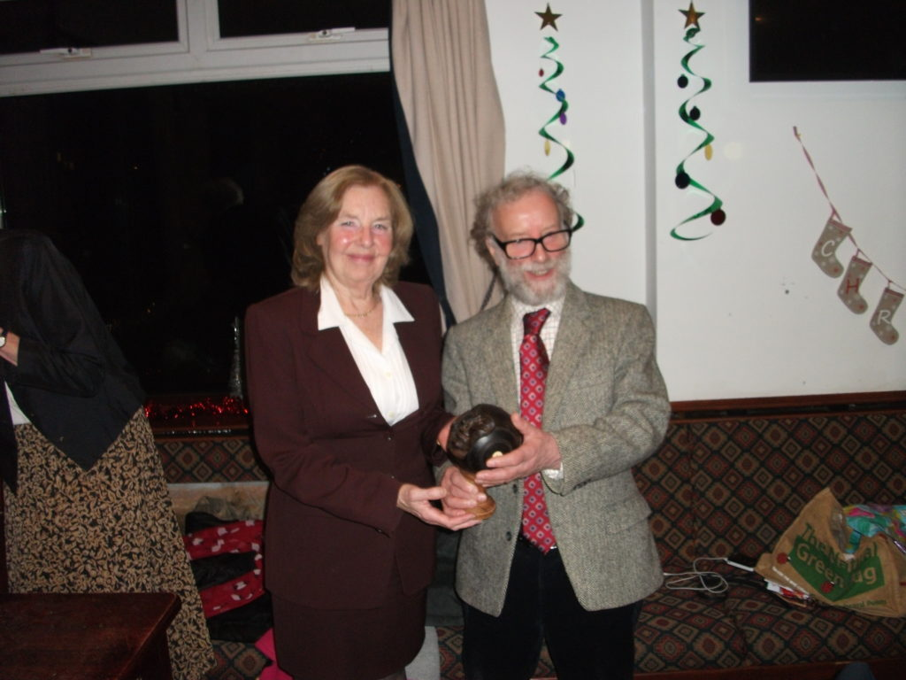 A special honour, Jenny Douglas receives the Club Champion of Champions Trophy.